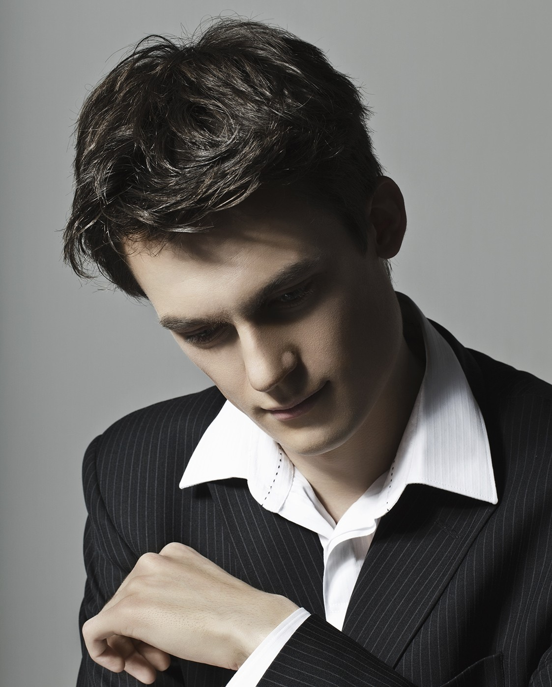 Pensive young man in suit